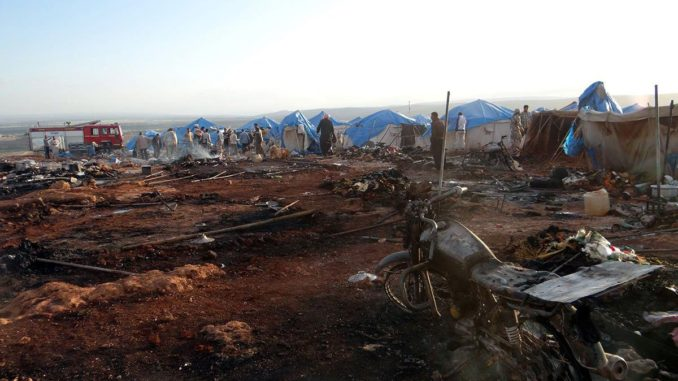 People inspect the damage after a Syrian regime warplane targeted the Kamuna refugee camp near the Syrian In the Idlib province after Syrian regime warplane targeted the camp on May 05, 2016. 8 people were killed and another 30 injured. Image by Anadolu