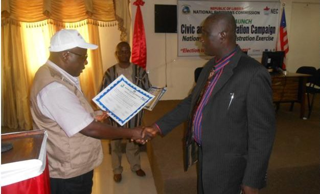Acting CDA Chairman, Augustine Nimely receiving the certificate from NEC Chairman