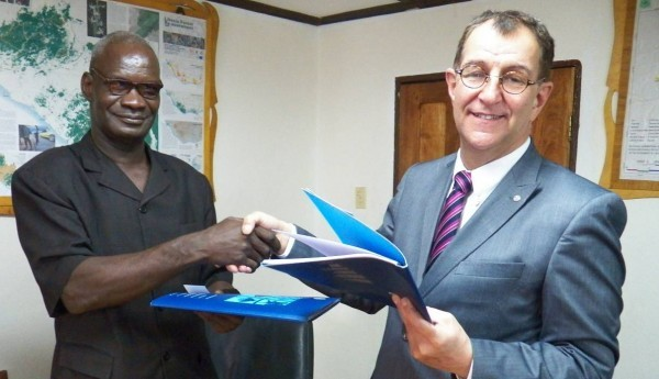 FDA Managing Director, Harrison Karnwea and FAO Country Representative Jean-Alexandre exchange documents