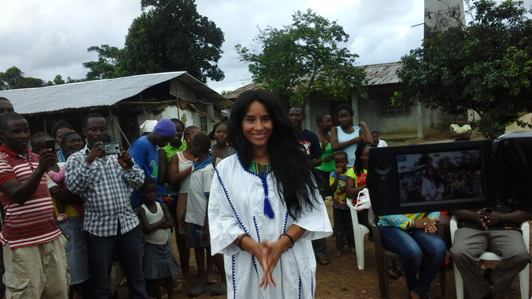 Ms. Kimberly Moore after being gowned by the people of Memeh Town