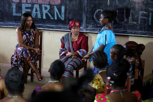 U.S. first lady Michelle Obama (L) sits with Liberian President Ellen Johnson Sirleaf as she talks with students at the R. S. Caulfield School girls center in Margibi County, Liberia, June 27, 2016. REUTERS/Thierry Gouegnon - RTX2IKSG