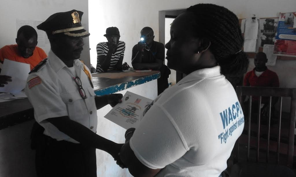 One of the female officers receiving her certificate