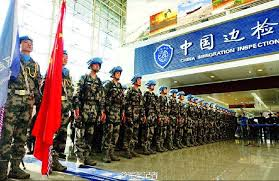 The picture shows a scene of the departure ceremony for Chinese peacekeepers. The last echelon of the first Chinese peacekeeping infantry battalion .