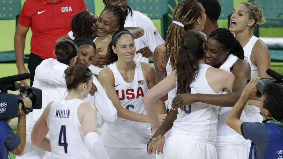 U.S. players celebrate after the gold medal basketball game against Spain at the 2016 Summer Olympics in Rio de Janeiro, Brazil, Aug. 20, 2016.