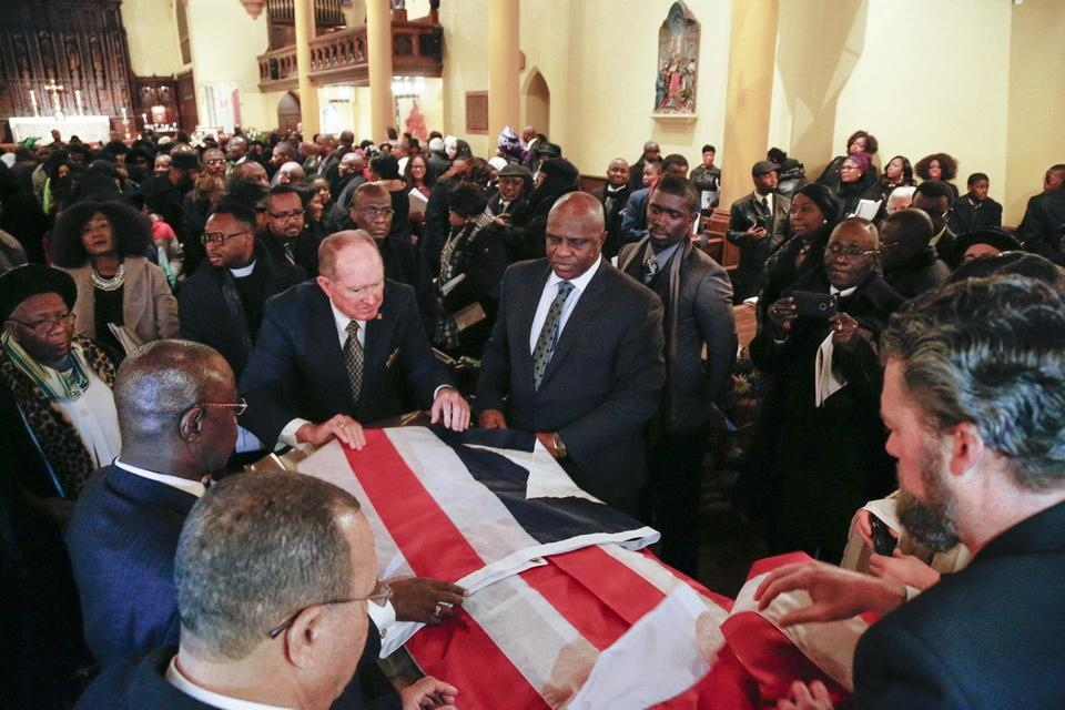 Casket bearing the remains of Ruth Sando Perry being viewed - Credit: The Columbus Dispatch