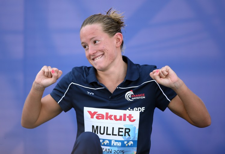 Gold medallist France's Aurelie Muller poses during the medal ceremony for the Women's 10km open water swimming event at the 2015 FINA World Championships in Kazan on July 28, 2015. AFP PHOTO / ROMAN KRUCHININ        (Photo credit should read ROMAN KRUCHININ/AFP/Getty Images)