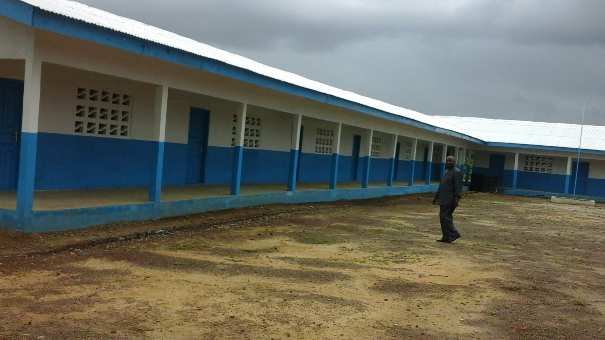 Bomi County Superintendent, Samuel Brown at the newly constructed school in his county