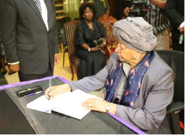 President Sirleaf signs the Book of Condolence of her fallen Chief of Staff, Dr. McClain. Photo Credit: Mr. James M. Garresen - Executive Mansion
