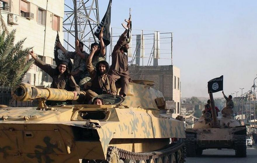 ISIS fighters parade in tanks in Raqqa, Syria. (AP)