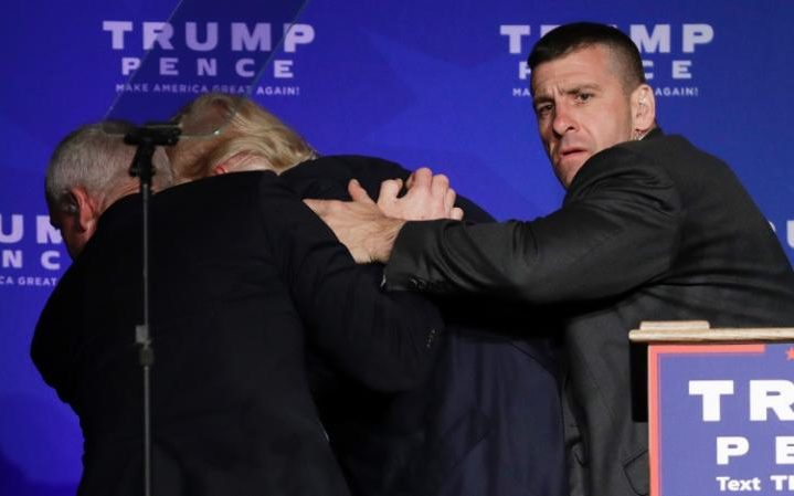 Trump being rushed off stage by security