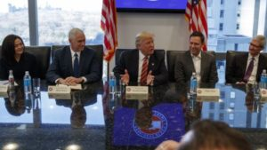 President-elect Donald Trump speaks during a meeting with technology industry leaders at Trump Tower in New York, Dec. 14, 2016. From left are, Facebook COO Sheryl Sandberg, Vice President-elect Mike Pence, Trump, PayPal founder Peter Thiel, and Apple CE
