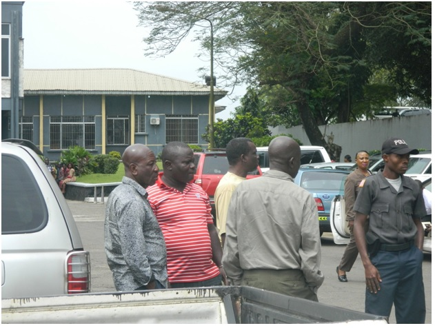 The three men being escorted to jail by Court officers