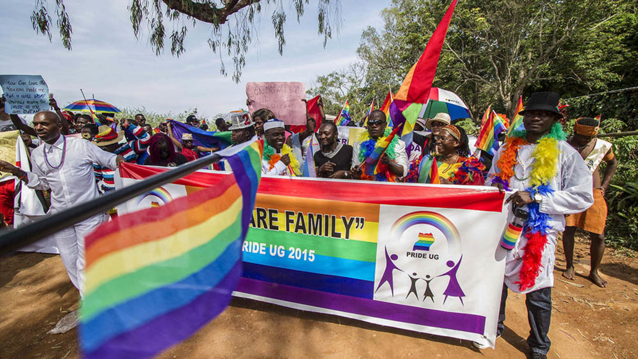 Participants hold rainbow flags during the Gay Pride parade in Entebbe, Uganda, in August last year. (Isaac Kasamani, AFP)