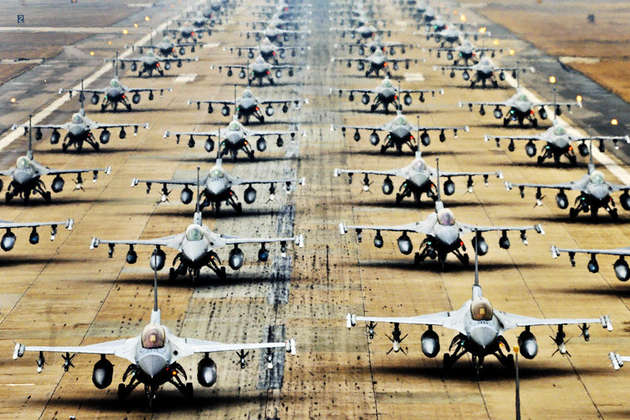 """120302-F-RB551-139 F-16 Fighting Falcons demonstrate an """"Elephant Walk"""" as they taxi down a runway during an exercise at Kunsan Air Base, South Korea, on March 2, 2012. The air crews are assigned to Kunsan Air Base and various bases around the U.S. as well as one group from the South Korean air force. DoD photo by Senior Airman Brittany Auld, U.S. Air Force. (Released)"""