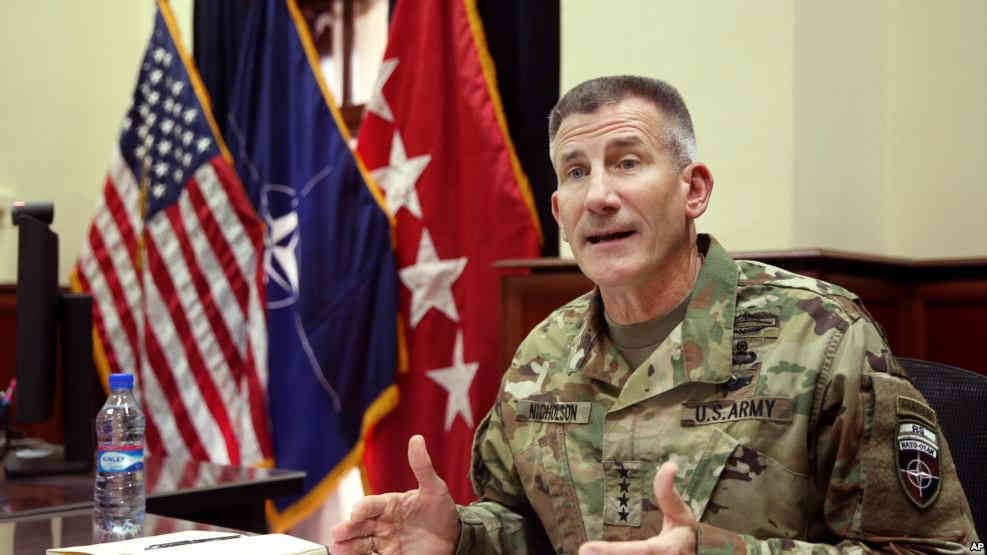 Head of NATO and U.S. forces in Afghanistan, U.S. Army Gen. John W. Nicholson, speaks during an interview with The Associated Press at his office, in Kabul, Afghanistan, July 27, 2016. Credit: VOA