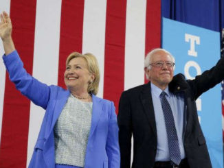 Democratic presidential candidate Hillary Clinton and Sen. Bernie Sanders stand together during a July 12 campaign rally in Portsmouth, N.H.