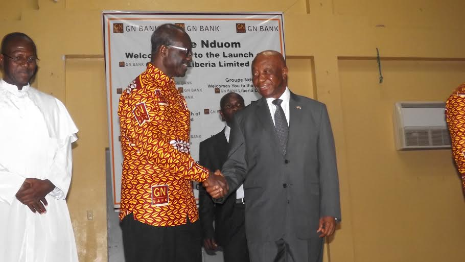GN Bank CEO In Handshake With Liberian Vice President