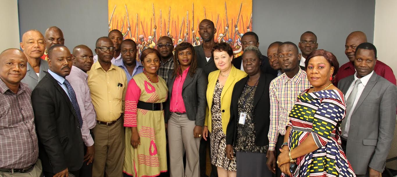 Madam Larisa Leshchenko and some members of her staff take a snap with media executives who were at the interactive forum today, September 27, 2016
