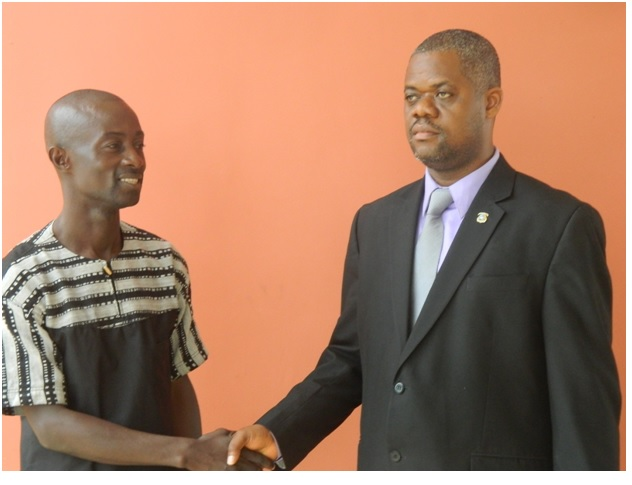 (L-R), MVTC Acting Director, Mr. Wilfred S.K. Payne in a handshake with the Deputy Minister of Youth and Sports, Rufus Neuville.