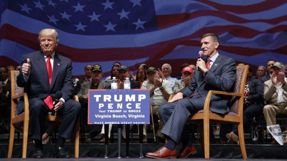 VOA FILE - Republican presidential candidate Donald Trump gives a thumbs up as he speaks with retired Lt. Gen. Michael Flynn during a town hall in Virginia Beach, Va., Sept. 6, 2016.