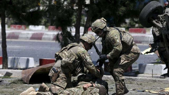 VOA NEWS FILE - U.S. soldiers attend to a wounded soldier at the site of a blast in Kabul, Afghanistan June 30, 2015.