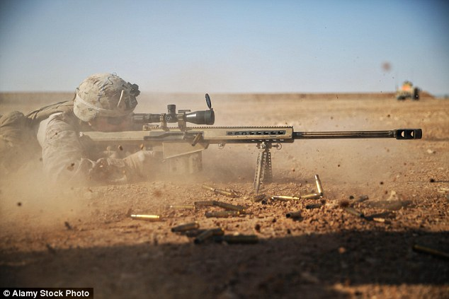 A British sniper took out a feared ISIS executioner as he prepared to murder several hostages by shooting a fuel tank on his back and incinerating him