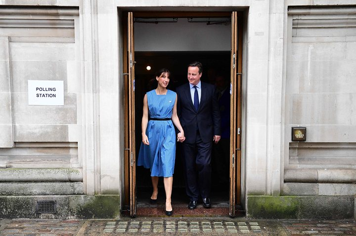David Cameron and his wife, Samantha, leave after casting their votes in London
