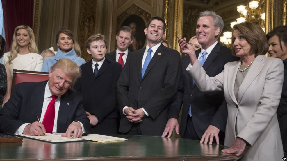 President Donald Trump is joined by the Congressional leadership and his family as he formally signs his cabinet nominations into law, in the President's Room of the Senate, at the Capitol in Washington, Jan. 20, 2017.