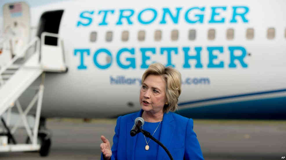 Democratic presidential candidate Hillary Clinton speaks to members of the media before boarding her campaign plane at Westchester County Airport in White Plains, New York, Sept. 8, 2016, to travel to a campaign rally in Charlotte, North Carolina.