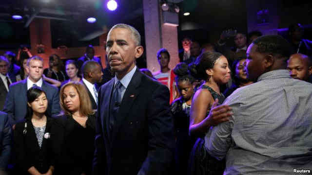 U.S. President Barack Obama meets members of the audience, including Cameron Sterling (R), son of Alton Sterling who was shot and killed by white police officers in Baton Rouge, after taking part in a televised town hall meeting