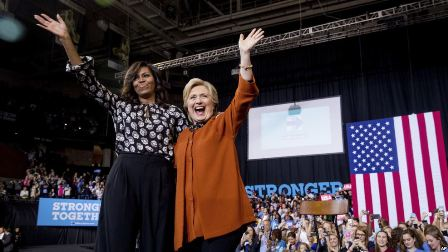 First lady Michelle Obama and Democratic presidential candidate Hillary Clinton wave together after speaking at a campaign rally at Wake Forest University in Winston-Salem, N.C., Oct. 27, 2016.