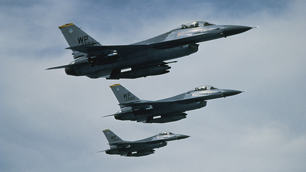 Low angle view of three F-16 Fighting Falcons flying in formation