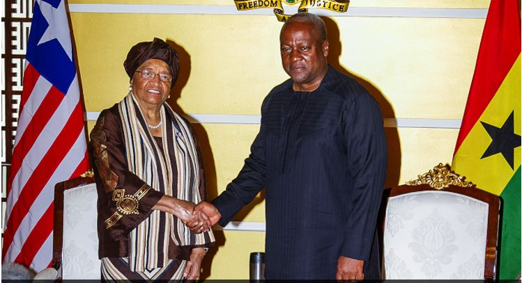 President Mahama in a handshake with President Ellen Johnson Sirleaf