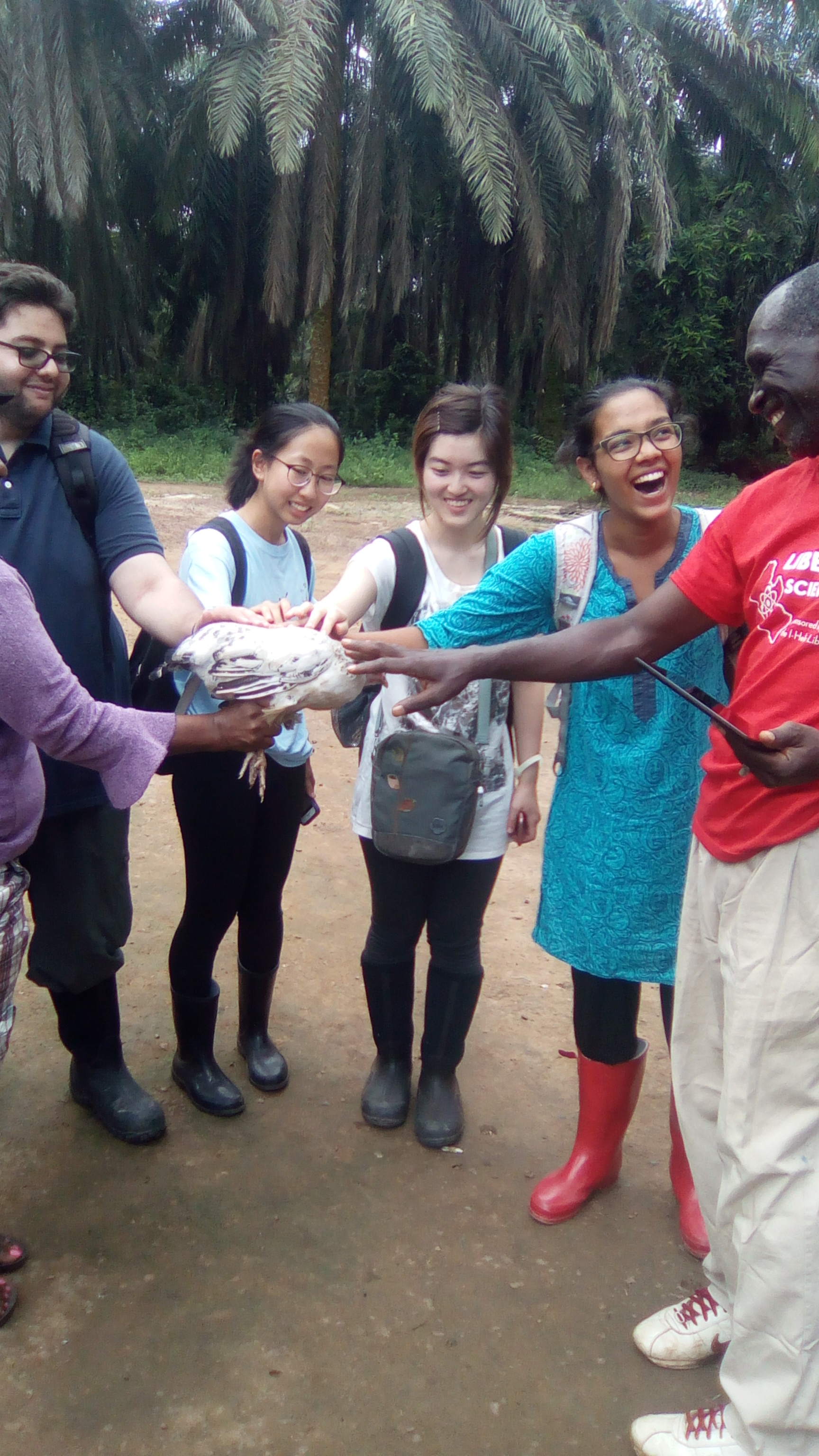 The students receiving the chicken with excitement