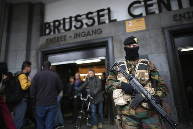 PROTECT: Armed guard stands outside Brussels airport after airport terrorist attack
