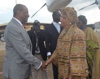 Liberian Leader Being Greeted By His Guinean Counterpart, President Alpha Conde.