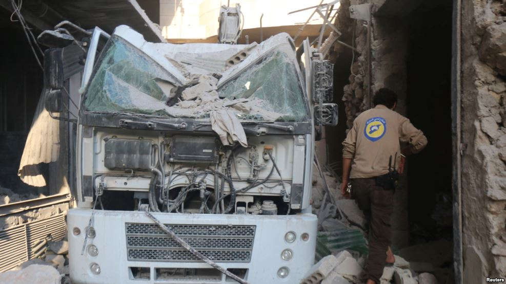 VOA FILE - A civil defense member inspects the damage after the agency's center was hit by an airstrike in a rebel-held area of Aleppo, Syria, Aug. 12, 2016.