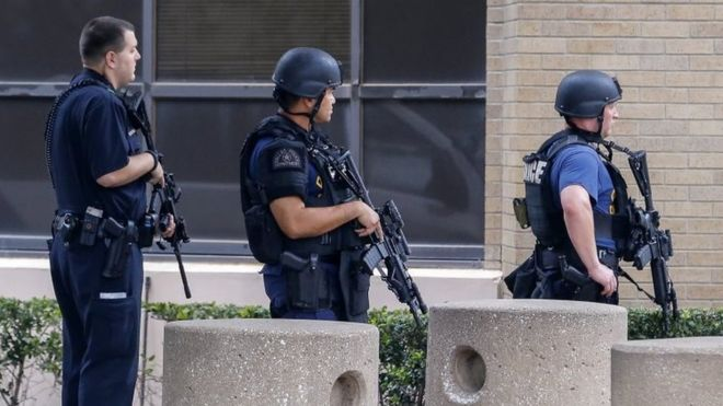 Armed police officers have been deployed at the main police headquarters in Dallas
