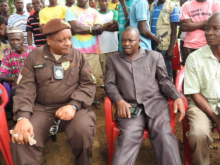 Immigration boss, Lemuel Reeves and Bomi County Superintendent, Samuel Brown in Tubmanburg to verify the information
