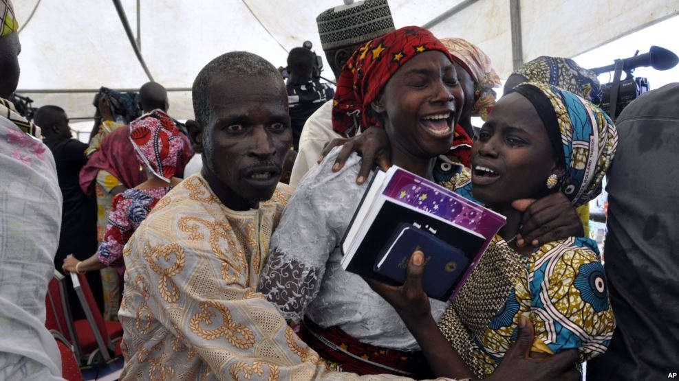 One of the freed Chibok girls celebrates with family members during a church service in Abuja, Nigeria, Oct. 16, 2016. Twenty-one girls were released Thursday and flown to Abuja, Nigeria's capital, but it's taken days for relatives to arrives