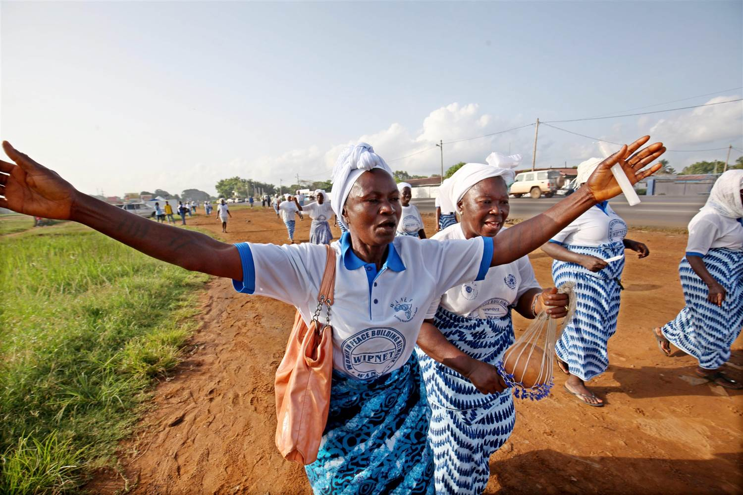 Liberia women celebrate in Monrovia, Liberia, 09 May 2015, the news of the end of deadly ebola outbreak in the country. AHMED JALLANZO / EPA