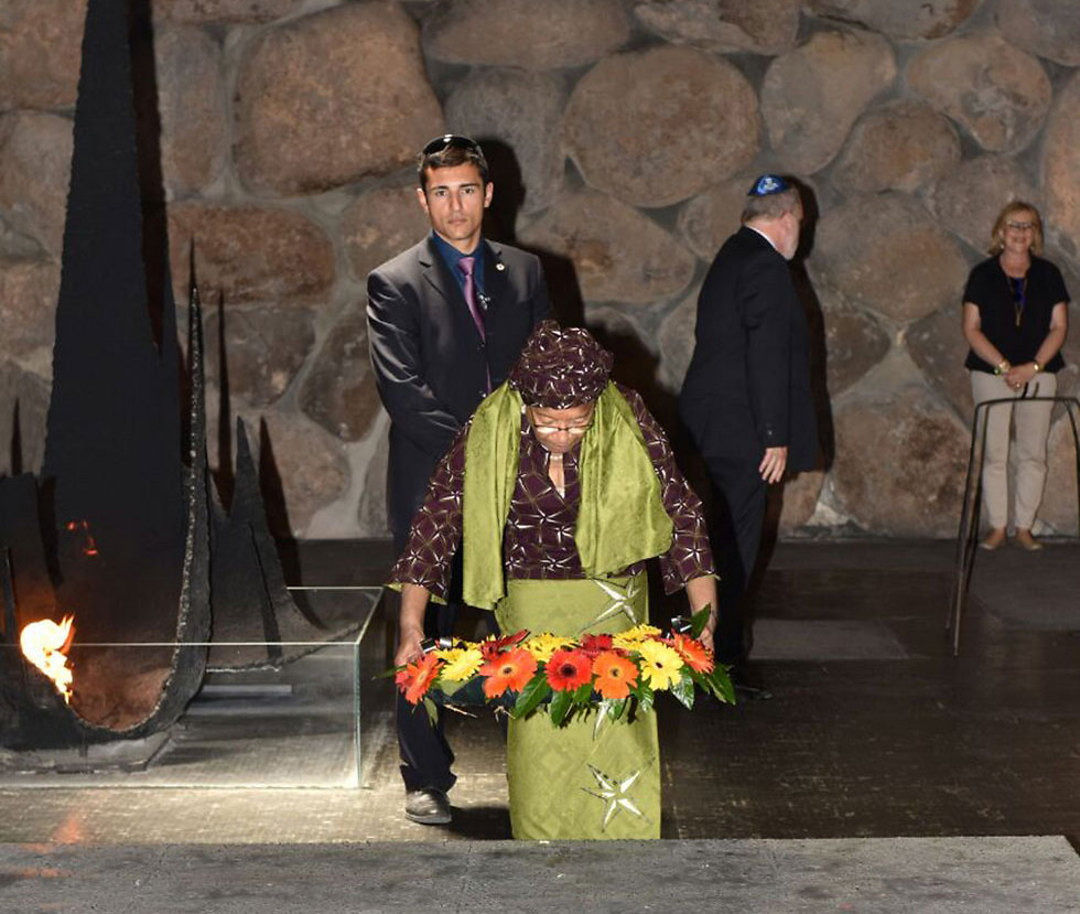 President Sirleaf lays a wreath at the Yad Vashem Hall of Remembrance (Photo: Shlomi Amsalem, Israeli Foreign Ministry) After landing in Israel she was taken to Moshav Kfar Shmuel next to Ramle and tasted Israeli cucumbers. She later met with Israeli entrepreneurs and is scheduled to meet with representatives of Israeli companies looking to invest in Liberia on Thursday.