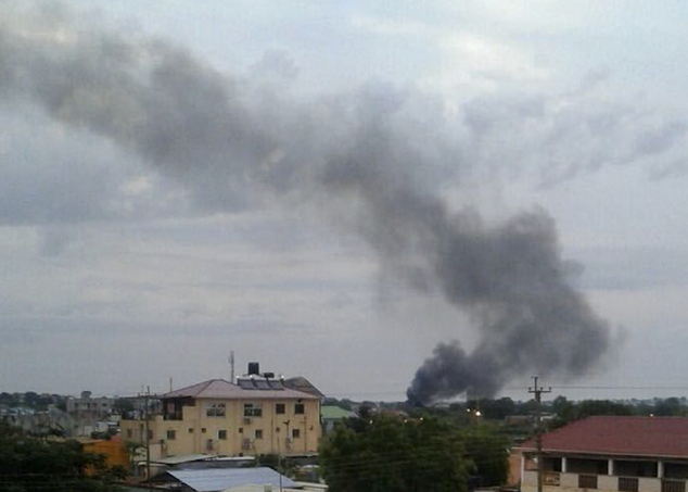 In this photo taken Sunday, July 10, 2016, black smoke is seen rising above the capital Juba, in South Sudan. Explosions and heavy weapons gunfire are shaking South Sudan's capital Juba Monday in the fifth day of clashes between government and opposition forces, raising the specter of a return to civil war. (Iain McLellan via AP)
