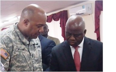 Major General Darryl Williams in close discussion with Defense Minister Brownie Samukai