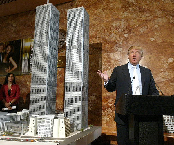 Donald Trump gestures as he addresses reporters next to a model of the proposed World Trade Center known as the Twin Towers II on May 18, 2005 in New York. (AP Photo/Mary Altaffer)