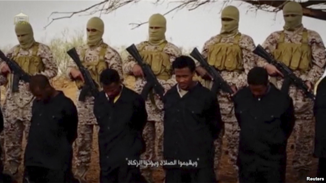 VOA FILE - Militants from the so-called Islamic State stand behind what are said to be Ethiopian Christians in Libya, in this still image from an undated video posted to a social media website on April 19, 2015.