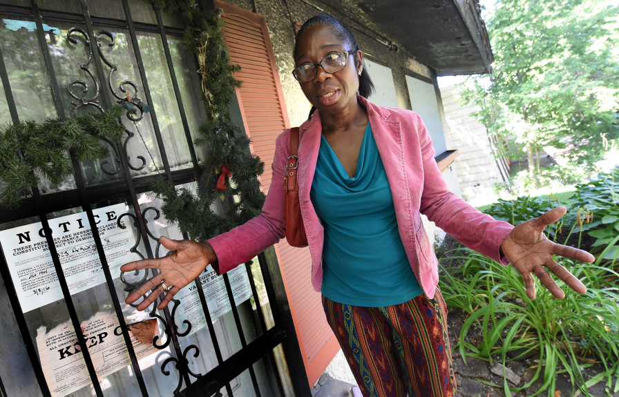 Florence Matadi, mother of Olympic runner Emmanuel Matadi who is competing for Liberia in the 2016 Summer Olympics, is overcoming many hardships Wednesday, August 11, 2016, including a house on 1325 Arkwright that burned down in 2013. Emmanuel had left the house that morning to make a college visit to Mankato. She said she texts and talks to Emmanuel every day. (Pioneer Press: Jean Pieri)