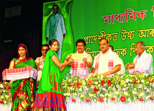 FLASH BACK PICTURE:  Assam education minister Himanta Biswa Sarma hands over an appointment letter to a candidate at the function organised at GMCH auditorium in Guwahati on Monday. Picture by UB Photos