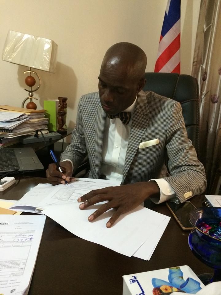 Minister Nagbe performing his official duties