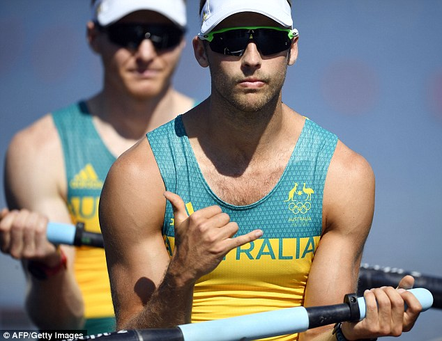 Australia rowers Alexander Lloyd, right, gestures beside Spencer Turrin during the Men's Pair competition at the Lagoa stadium in Rio